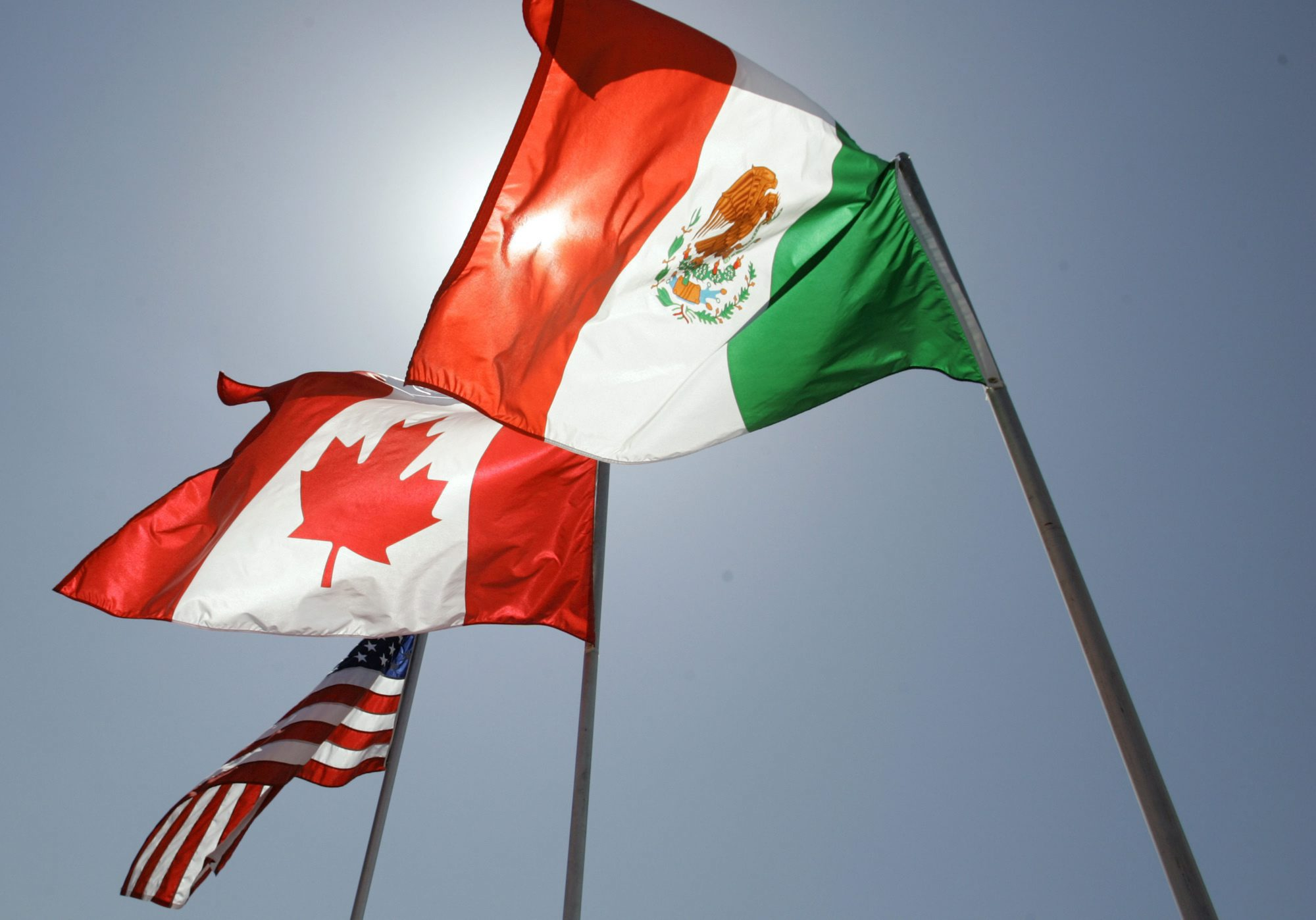 National flags representing the United States Canada and Mexico fly in the breeze